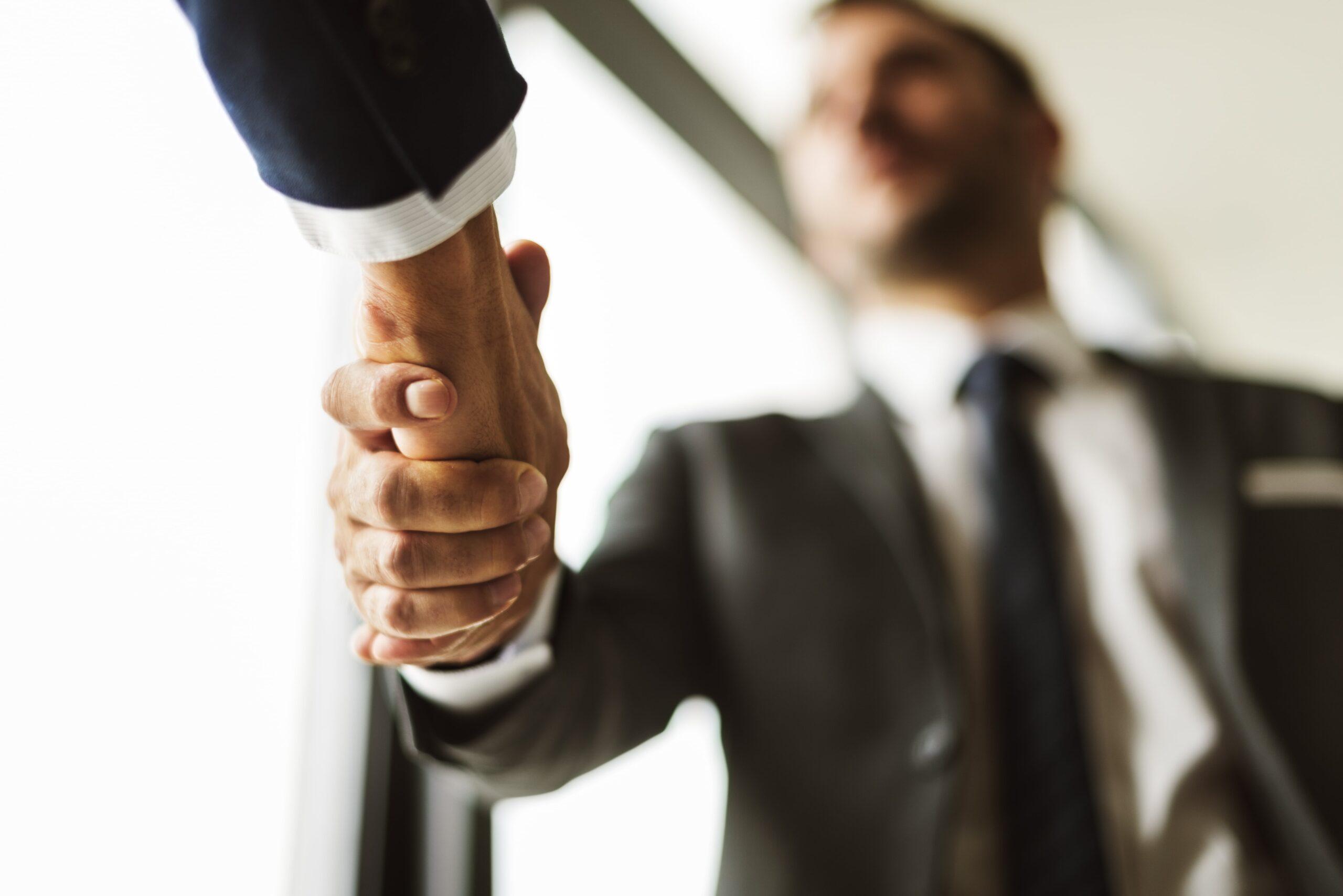 deal-businessmen-handshake-partnership-concept-PF3GLKS-min